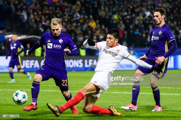 Sevilla's Argentinian midfielder Joaquin Correa vies with Maribor's Slovenian defender Martin Milec and Slovenian forward Gregor Bajde during the...
