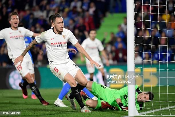 Sevilla's Argentinian midfielder Lucas Ocampos celebrate after scoring during the Spanish league football match Getafe CF against Sevilla FC at the...