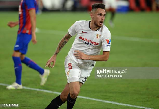 Sevilla's Argentinian midfielder Lucas Ocampos celebrates after scoring a goal during the Spanish League football match between Sevilla FC and SD...