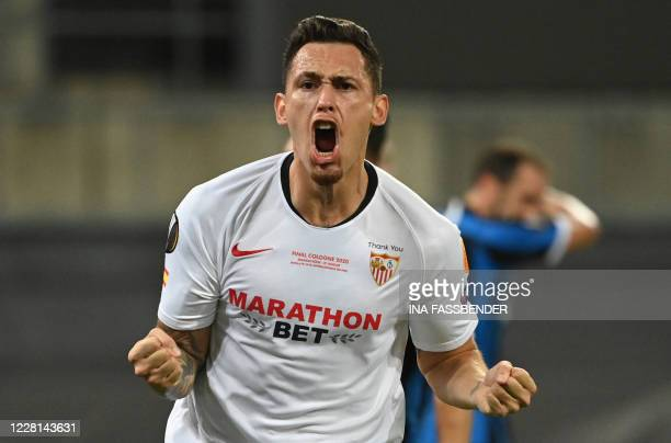 TOPSHOT Sevilla's Argentinian midfielder Lucas Ocampos celebrates after his team scored the 11 goal during the UEFA Europa League final football...