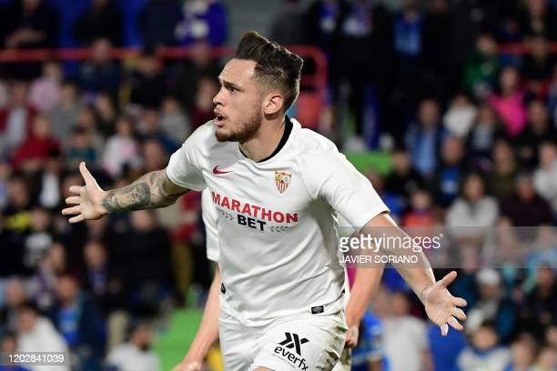 Sevilla's Argentinian midfielder Lucas Ocampos celebrates after scoring during the Spanish league football match Getafe CF against Sevilla FC at the...