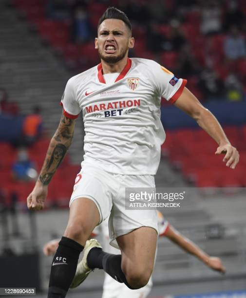 Sevilla's Argentinian midfielder Lucas Ocampos celebrates scoring the opening goal from the penalty spot during the UEFA Super Cup football match...
