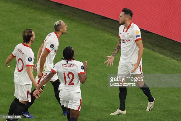 Sevilla's Argentinian midfielder Lucas Ocampos celebrates scoring the opening goal with his teammates from the penalty spot during the UEFA Super Cup...