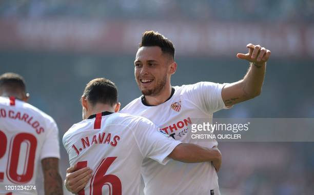 Sevilla's Argentinian midfielder Lucas Ocampos celebrates with Sevilla's Spanish midfielder Jesus Navas after scoring a goal during the Spanish...