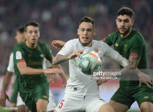Sevilla's Argentinian midfielder Lucas Ocampos fights for the ball with Athletic Bilbao's Spanish defender Unai Nunez during the Spanish league...