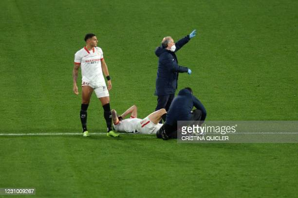 Sevilla's Argentinian midfielder Lucas Ocampos receives medical assistance during the Spanish league football match between Sevilla FC and Getafe CF...