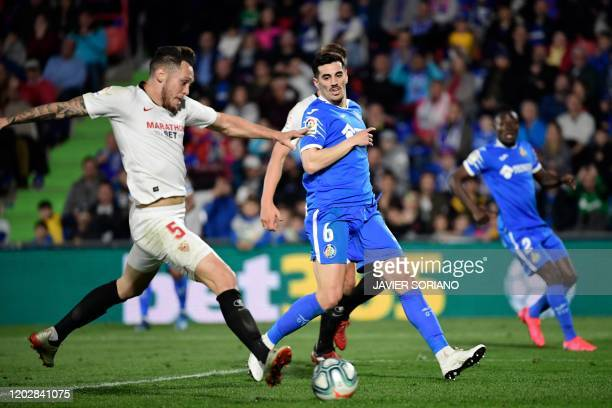 Sevilla's Argentinian midfielder Lucas Ocampos scores during the Spanish league football match Getafe CF against Sevilla FC at the Coliseum Alfonso...