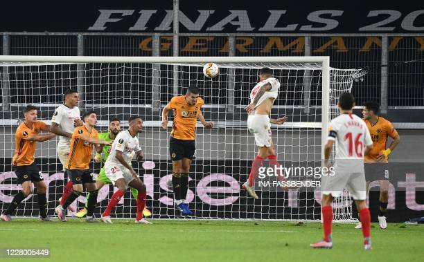 Sevilla's Argentinian midfielder Lucas Ocampos scores the opening goal during the UEFA Europa League quarterfinal football match Wolverhampton...