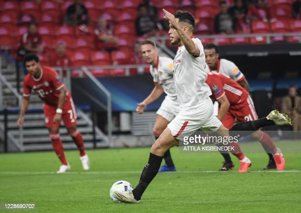 Sevilla's Argentinian midfielder Lucas Ocampos scores the opening goal from the penalty spot during the UEFA Super Cup football match between FC...