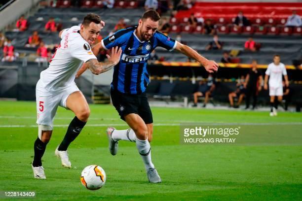 Sevilla's Argentinian midfielder Lucas Ocampos vies for the ball with Inter Milan's Dutch defender Stefan de Vrij during the UEFA Europa League final...