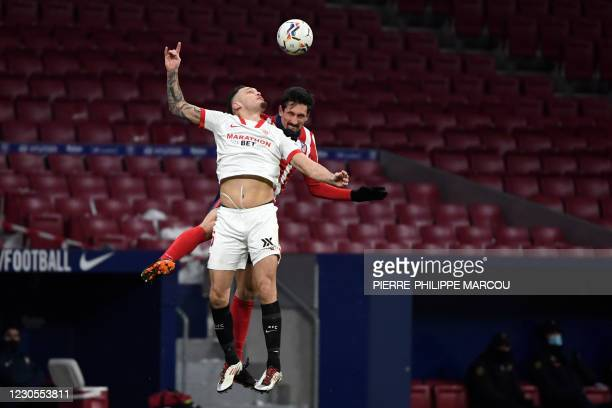 Sevilla's Argentinian midfielder Lucas Ocampos vies with Atletico Madrid's Montenegrin defender Stefan Savic during the Spanish League football match...
