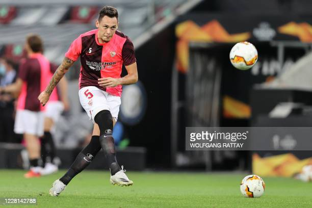 Sevilla's Argentinian midfielder Lucas Ocampos warms up prior to the UEFA Europa League final football match Sevilla v Inter Milan on August 21 in...