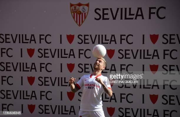 Sevilla´s Argentinian new forward Alejandro Gomez aka 'Papu Gomez' controls the ball during his presentation at the Ramon Sanchez Pizjuan stadium in...