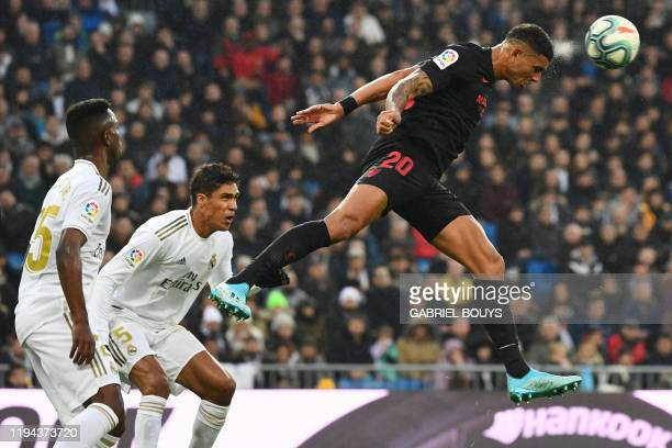 Sevilla's Brazilian defender Diego Carlos heads the ball during the Spanish league football match between Real Madrid CF and Sevilla FC at the...