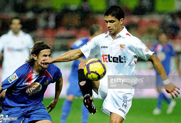 Sevilla's Brazilian midfielder Renato competes with Getafe's defender David Cortes during a Spanish King�s Cup football match at Sanchez Pizjuan...