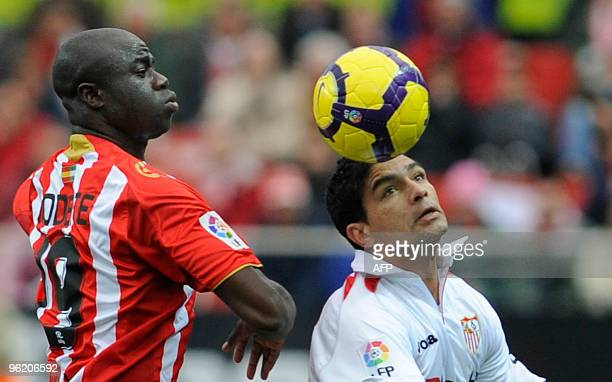 Sevilla's Brazilian midfielder Renato vies with Almeria's midfielder M Bami during a Spanish league football match at Sanchez Pizjuan stadium in...