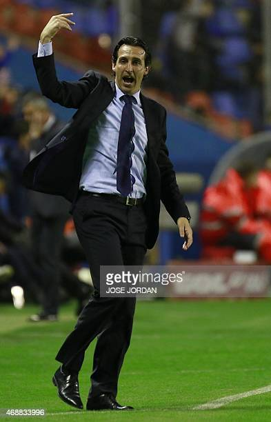 Sevilla's coach Unai Emery gestures from the sidelines during the Spanish league football match Levante UD vs Sevilla FC at the Ciutat de Valencia...