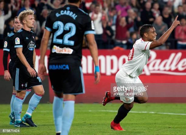 Sevilla's Colombian forward Luis Muriel celebrates a goal during the Spanish league football match Sevilla vs Celta Vigo at the Ramon Sanchez Pizjuan...