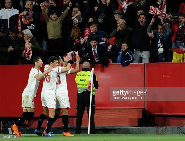 Sevilla's Colombian forward Luis Muriel celebrates a goal during the Spanish League football match between Sevilla FC and FC Barcelona at the Ramon...