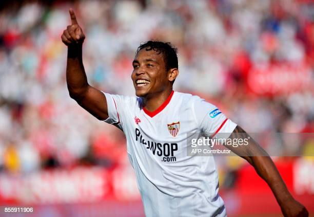 Sevilla's Colombian forward Luis Muriel celebrates after scoring a goal during the Spanish league football match Sevilla FC vs Malaga CF at the Ramon...