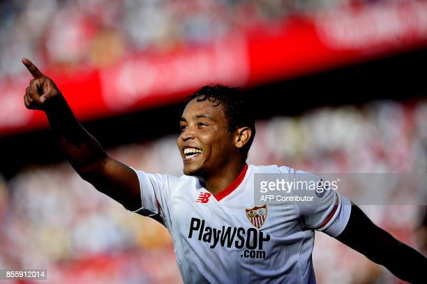 Sevilla's Colombian forward Luis Muriel celebrates after scoring a goal during the Spanish league football match Sevilla FC vs Malaga CF at the Ramon...