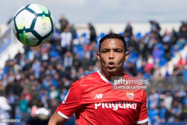 Sevilla's Colombian forward Luis Muriel eyes the ball during the Spanish League football match between Club Deportivo Leganes SAD and Sevilla FC at...