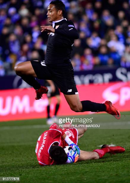 Sevilla's Colombian forward Luis Muriel jumps over Levante´s Argentinian goalkeeper Nereo Champagne during the Spanish 'Copa del Rey' first leg...