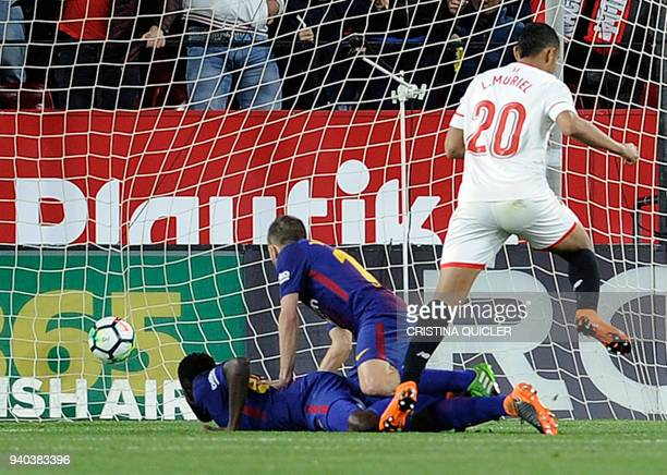 Sevilla's Colombian forward Luis Muriel scores a goal during the Spanish League football match between Sevilla FC and FC Barcelona at the Ramon...