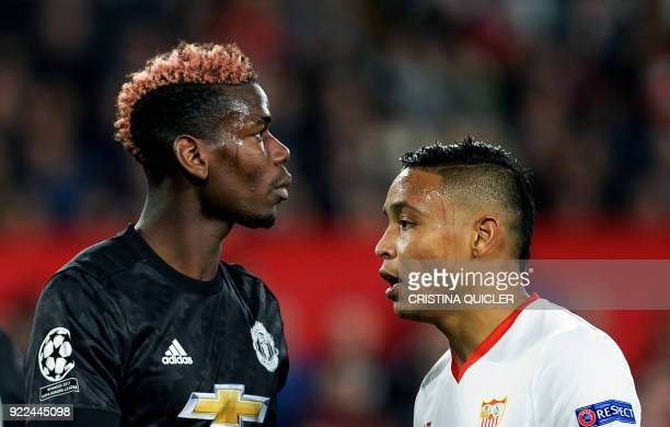 Sevilla's Colombian forward Luis Muriel walks next to Manchester United's French midfielder Paul Pogba during the UEFA Champions League round of 16...