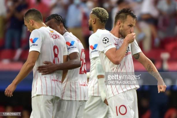 Sevilla's Croatian midfielder Ivan Rakitic celebrates scoring Sevilla's first goal during the UEFA Champions League first round group G football...