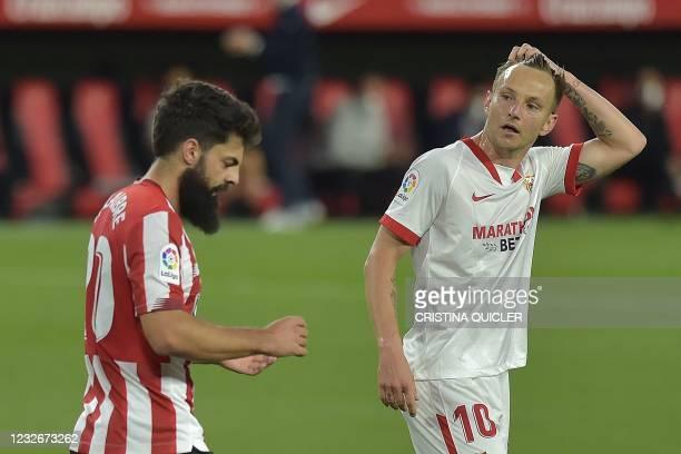 Sevilla's Croatian midfielder Ivan Rakitic reacts next to Athletic Bilbao's Spanish forward Asier Villalibre during the Spanish League football match...