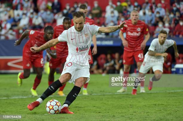 Sevilla's Croatian midfielder Ivan Rakitic shoots a penalty kick and scores sevilla's first goal during the UEFA Champions League first round group G...