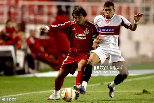Sevilla's Daniel and Lokomotiv Moscow's Dmitri Loskov battle for the ball