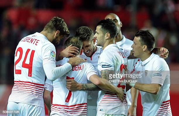 Sevilla's Danish midfielder Michael KrohnDehli celebrates with teammates after scoring during the Spanish Copa del Rey semifinal first leg football...