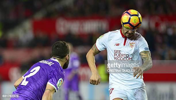 Sevilla's Danish midfielder Michael KrohnDehli vies with Real Madrid's defender Dani Carvajal during the Spanish league football match Sevilla FC vs...