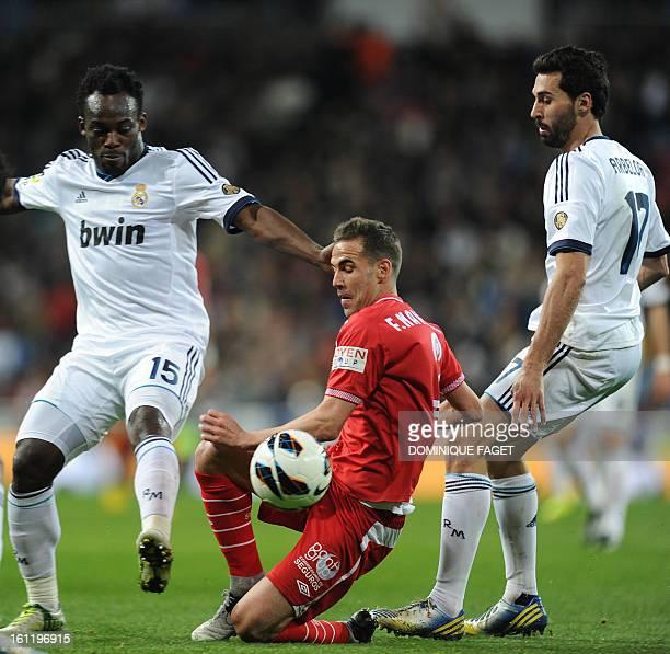 Sevilla's defender Fernando Navarro vies with Real Madrid's Ghanaian midfielder Michael Essien and Real Madrid's defender Alvaro Arbeloa during the...