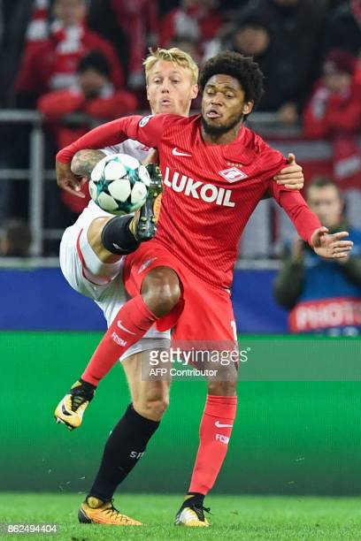 Sevilla's defender from Denmark Simon Kjaer and Spartak Moscow's forward from Brazil Luiz Adriano vie for the ball during the UEFA Champions League...