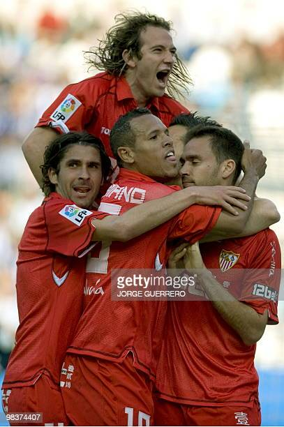 Sevilla's defender Lolo celebrates with teammates Diego Capel , Luis Fabiano and Julien Escude after scoring against Malaga during a Spanish league...