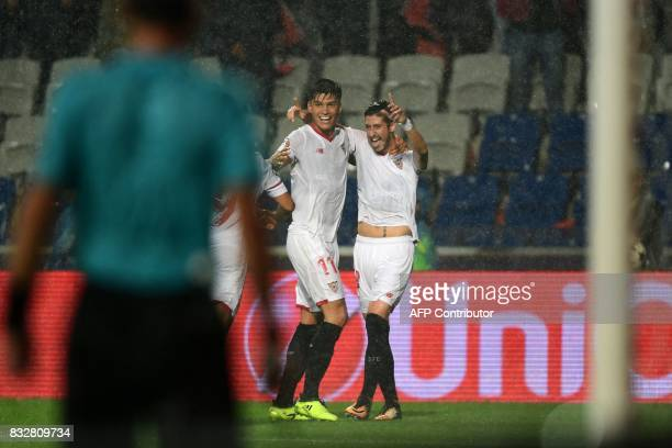 Sevilla's defender Sergio Escudero celebrates with his teammates after scoring a goal during the UEFA Champions League play-off first leg football...
