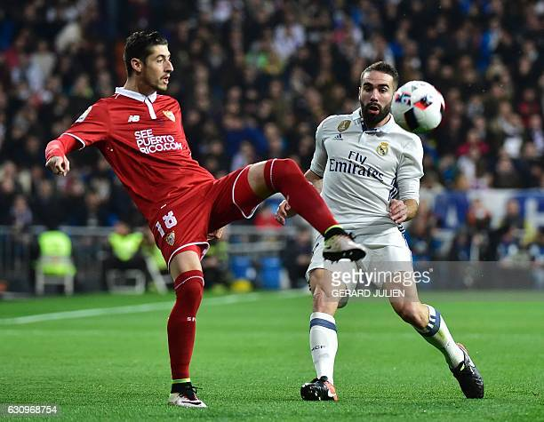 Sevilla's defender Sergio Escudero vies with Real Madrid's defender Dani Carvajal during the Spanish Copa del Rey round of 16 first leg football...