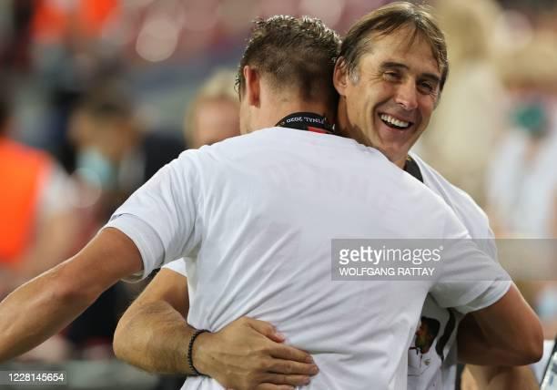 Sevilla's Dutch forward Luuk De Jong and Sevilla's Spanish coach Julen Lopetegui celebrate after winning the UEFA Europa League final football match...