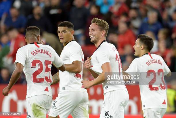 Sevilla's Dutch forward Luuk De Jong celebrates a goal during the Spanish league football match Sevilla FC vs Levante UD at the Ramon Sanchez Pizjuan...