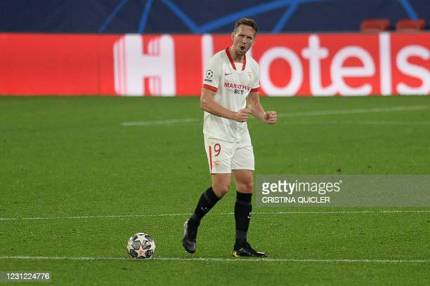 Sevilla's Dutch forward Luuk De Jong celebrates after scoring a goal during the UEFA Champions League round of 16 first leg football match between...