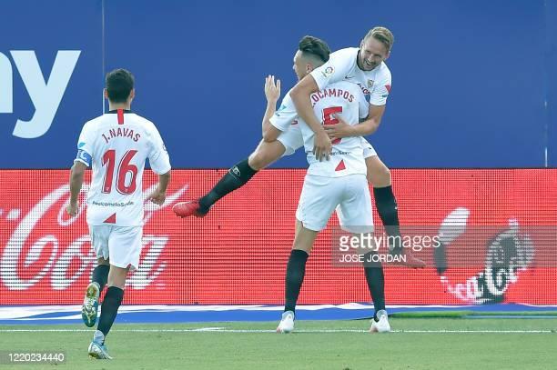 Sevilla's Dutch forward Luuk De Jong celebrates his goal with Sevilla's Argentinian midfielder Lucas Ocampos during the Spanish League football match...
