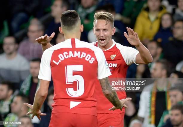 Sevilla's Dutch forward Luuk De Jong celebrates with Sevilla's Argentinian midfielder Lucas Ocampos after scoring a goal during the Spanish league...