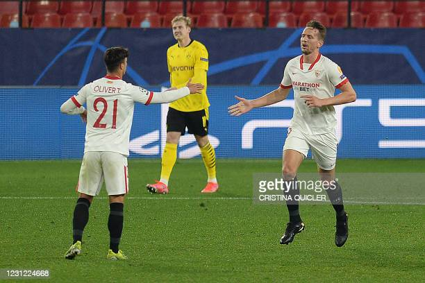 Sevilla's Dutch forward Luuk De Jong celebrates with Sevilla's Spanish midfielder Olivier Torres after scoring a goal during the UEFA Champions...
