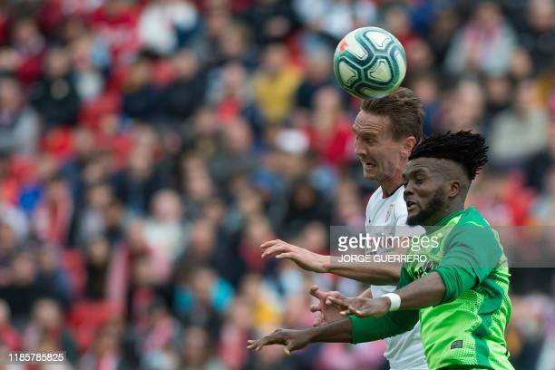 Sevilla's Dutch forward Luuk De Jong vies with Leganes' Nigerian defender Chidozie Awaziem during the Spanish league football match between Sevilla...