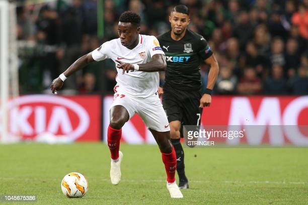Sevilla's Dutch forward Quincy Promes and FK Krasnodar's midfielder Wanderson vie for the ball during the UEFA Europa League group J football match...