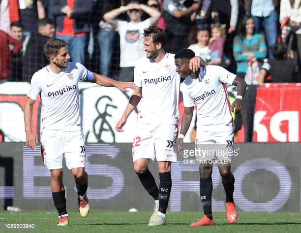 Sevilla's Dutch midfielder Quincy Promes celebrates his goal with Sevilla's ItalianArgentinian midfielder Franco Vazquez and Sevilla's Portuguese...