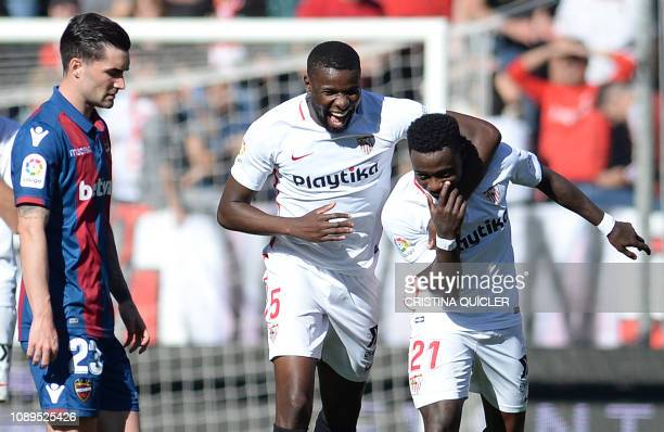 Sevilla's Dutch midfielder Quincy Promes celebrates his goal with Sevilla's French defender Ibrahim Amadou during the Spanish league football match...